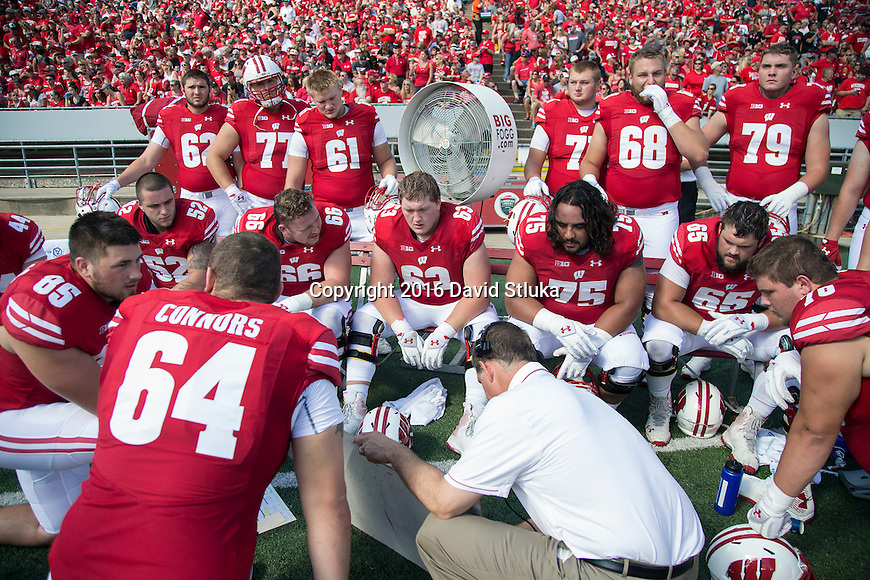 Wisconsin Badgers offensive coordinator Joe Rudolph coaches the offensive line on the sideline during an NCAA college football game against the Georgia State Panthers Saturday, September 17, 2016, in Madison, Wis. The Badgers won 23-17. (Photo by David Stluka)