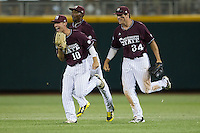 Mississippi State outfielder CT Bradford (10), Demarcus Henderson (2) and Hunter Refroe (34) celebrate the end of Game 6 of the 2013 Men's College World Series on June 17, 2013 at TD Ameritrade Park in Omaha, Nebraska. The Bulldogs defeated Hoosiers 5-4. (Andrew Woolley/Four Seam Images)