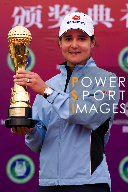 HAIKOU, CHINA - OCTOBER 31:  Lorena Ochoa of Mexico poses with the Mission Hills Start Trophy after winning the tournament at Mission Hills Resort on October 31, 2010 in Haikou, China.  The Mission Hills Star Trophy is Asia's leading leisure liflestyle event and features Hollywood celebrities and international golf stars. Photo by Victor Fraile / The Power of Sport Images