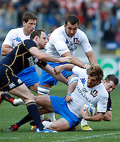 Six Nations rugby tournament: Italy vs Scotland. Rome, Olympic stadium, 17 march 2012..Torneo Sei Nazioni di rugby: Italia-Scozia. Roma, stadio Olimpico, 17 marzo 2012..Italy's Mirco Bergamasco is tackled by Scotland's Greig Laidlaw, bottom right..UPDATE IMAGES PRESS/Riccardo De Luca
