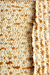 Matzo, Matza or matzah; is an unleavened bread traditionally eaten by Jews during the week-long Passover holiday