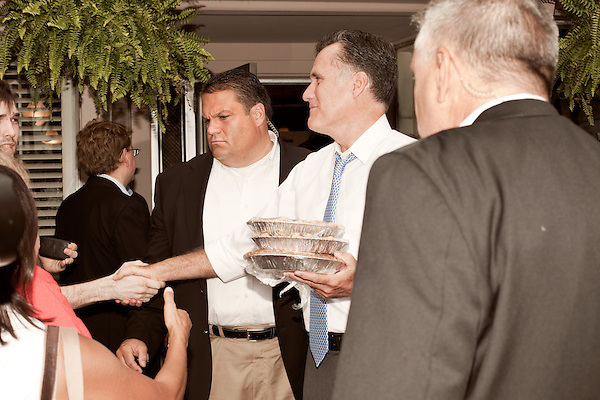 August 11, 2012. Ashland, VA.. Republican Presidential candidate Mitt Romney greets the crowd during a stop at Homemades by Suzanne, a local restaurant and caterer. Gov. Romney bought 3 pies during the stop, apple, pecan and chocolate chess..  Republican presidential candidate Mitt Romney campaigned through Virginia and North Carolina over the weekend, showing off his new vice presidential pick Paul Ryan. The candidates stopped at several small businesses highlighting their promise to champion the needs of business owners across the country.