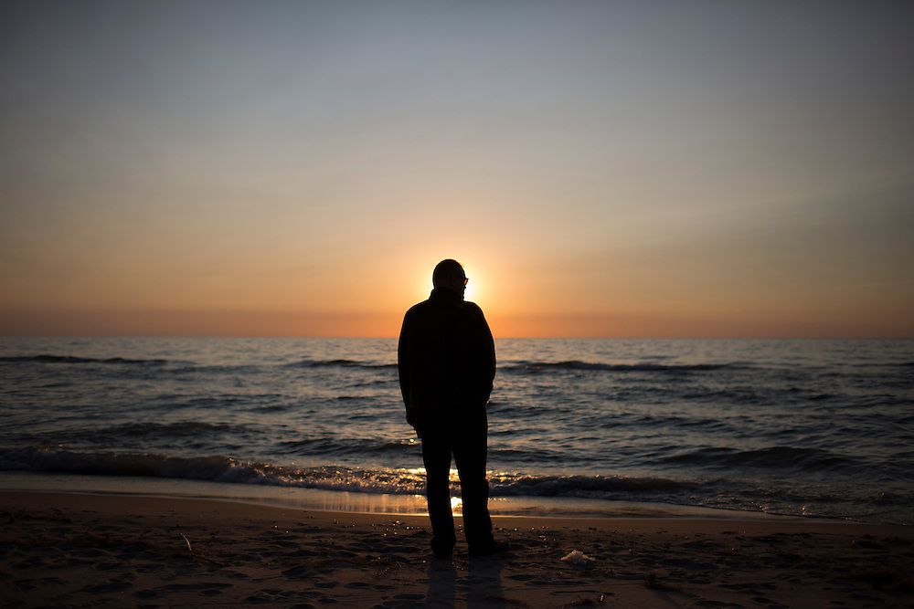 Tom Cullen stands on the beach on Saturday, May 21, 2016, in Lakeside, Michigan. (Photo by James Brosher)