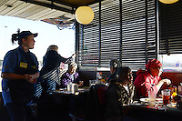 Customers are seen at a Waffle House in Nashville, Tennessee on January 4, 2012.