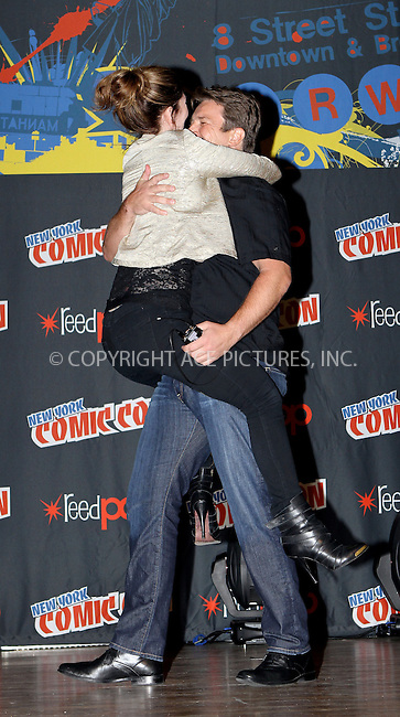 WWW.ACEPIXS.COM....October 13 2012, New York City....Nathan Fillion and Jewel Staite at the 2012 New York Comic Con at the Javits Center on October 13, 2012 in New York City....By Line: Nancy Rivera/ACE Pictures......ACE Pictures, Inc...tel: 646 769 0430..Email: info@acepixs.com..www.acepixs.com