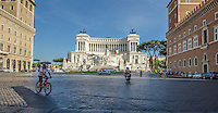 Travel Print Photograph. Architectural street photograph of The Monumento Nazionale a Vittorio Emanuele II or Altare della Patria or &quot;Il Vittoriano&quot; is a monument built to honour Victor Emmanuel, the first king of a unified Italy.  <br /> This wide low angle perspective photograph puts the viewer on the street of this famous building.  The blue sky and sun's spot lighting effect makes the white marble of this building to stand out from the street and all of the other buildings.