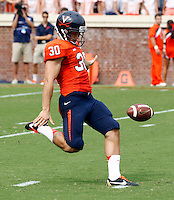 Virginia punter Alec Vozenilek (30) punts the ball  during the first half of the game in Charlottesville, Va. Virginia defeated Brigham Young 19-16. Photo/Andrew Shurtleff