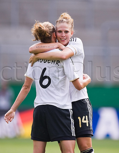 07 06 2011  Simon cheering Kim Kulig r with Simone Laudehr ger After the goal for 2 0 Womens International Football. Germany versus Holland.  in Aachen