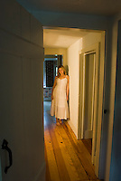 Blonde woman standing in hallway