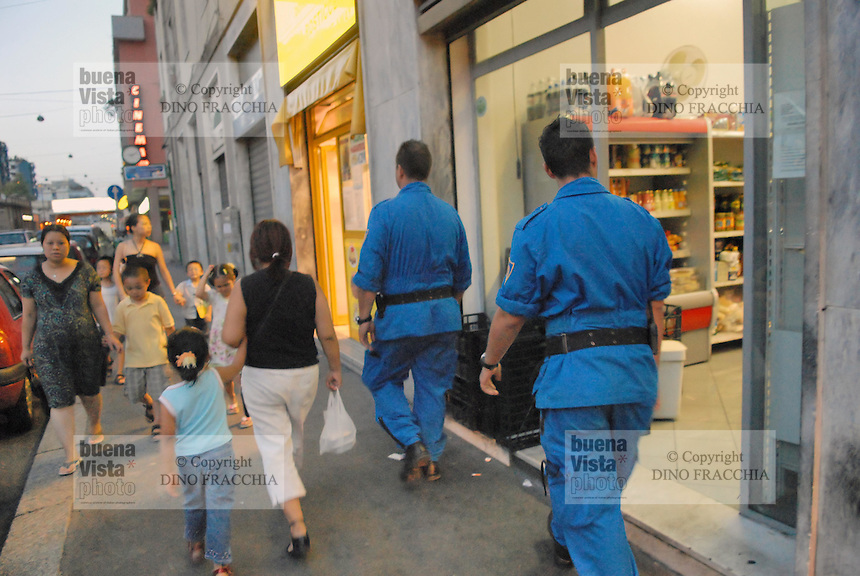 "- volunteers of  ""Blue Berets"" association in security service for Milan Municipality in Padova street, district considered at sea for the high presence of immigrants....- volontari dell'associazione ""Blue Berets"" in servizio di sicurezza per il Comune di Milano in  via Padova, quartiere considerato a rischio per l' alta presenza di immigrati"