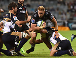 Sharks player  Jean-Luc du Preez is tackled by Brumbies players during the Super Rugby match between the ACT Brumbies and the South African Sharks in Canberra on March 4, 2017. AFP PHOTO / MARK GRAHAM --- IMAGE RESTRICTED TO EDITORIAL USE - STRICTLY NO COMMERCIAL USE --