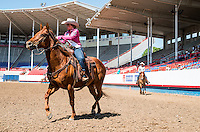 Miss Rodeo Colorado 2016 contestants from left, Tess Mahoney and Kellie Stockton during the horsemanship competition at the Miss Rodeo Queen Colorado competition at the Greely Stampede in Greely, Colorado, July 1, 2015.<br /> <br /> Photo by Matt Nager