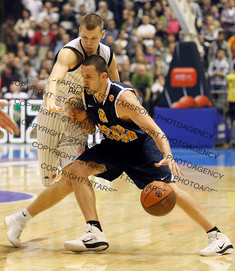 Poland's BC Asseco Prokom player Filip Videnov, right in action against Serbia's BC Partizan player Jaka Klobucar, left, during a Euroleague basketball match in Belgrade, Serbia, Wednesday, Dec. 15, 2010. (Srdjan Stevanovic/Starsportphoto.com)