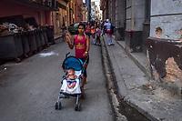 HAVANA, CUBA - SEPTEMBER 08: Cubans A woman walks a stroller through Old Havana on 8th of September, 2015 in Havana, Cuba. Daniel Berehulak for The New York Times