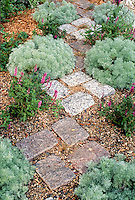 Unique stone path through herb garden using cut stone as stepping stones