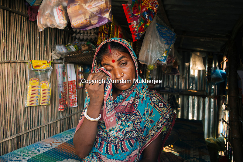 Rita Mondol breaks down into tears as she talks about how her house was eaten away by the river in front of her eyes and how she's running a family of 3 children with a semi paralyzed husband. Kulidihar village, Murshidabad District, West Bengal, India.