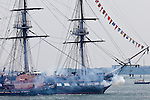 The USS Constitution fires a 21-gun salute at Fort Independence on her July 4th annual Turnaround Cruise in Boston Harbor, Boston, MA, USA