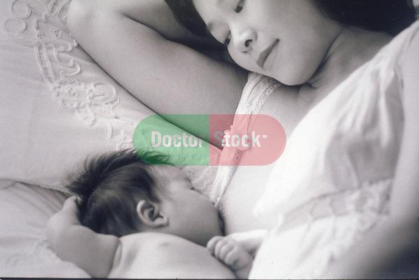 mother breast feeding infant