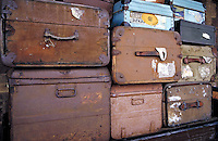 Suitcases stacked at a railway station in England. travel, containers. England.