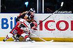Stockholm 2013-12-28 Ishockey Hockeyallsvenskan Djurg&aring;rdens IF - Almtuna IS :  <br /> Djurg&aring;rden Dustin Johner trycker ner Almtuna Linus Rotbakken  vid sargen<br /> (Foto: Kenta J&ouml;nsson) Nyckelord: