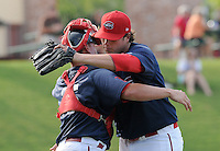 Starting pitcher Kyle Stroup (40) of the Greenville Drive is congratulated after pitching a 7-inning, complete-game 3-2 win in the first game of a doubleheader against the Rome Braves on August 15, 2011, at Fluor Field at the West End in Greenville, South Carolina. (Tom Priddy/Four Seam Images)