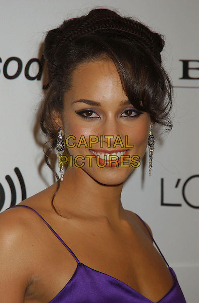 ALICIA KEYS.2006 Clive Davis Pre-GRAMMY Party sponsored by L'Oreal, Rhapsody, and XM Satellite Radio held at the Beverly Hilton Hotel, Beverly Hills, California, USA..February 6th, 2006.Photo: Laura Farr/AdMedia/Capital Pictures.Ref: LF/ADM.headshot portrait dangling diamond earrings.www.capitalpictures.com.sales@capitalpictures.com.© Capital Pictures.