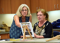 NWA Democrat-Gazette/FLIP PUTTHOFF<br />ARTISTS AT WORK<br />Barbara Iglehart (left), instructor, helps Kat Cieciwa (cq) with Cieciwa's drawing on Wednesday Feb. 28 2018 during a pastel class at the Rogers Adult Wellness Center. Pastel classes are held at the center each Tuesday and Wednesday, Iglehart said.