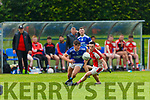 Eoin Clifford Laune Rangers turns PAul Murphy in front of the Rathmore bench  during their IFC clash in Killarney Friday evening