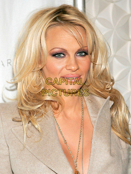 PAMELA ANDERSON.At the an event hosted by PETA (People for the Ethical Treatment of Animals) to honor people who have made outstanding contributions in promoting PETA campaigns that take a stand against cruelty to animals,.New York, NY, USA, 03 February 2006. .portrait headshot cleavage beige coat plunging neckline gold necklaces.Ref: ADM/JL.www.capitalpictures.com.sales@capitalpictures.com.© Capital Pictures.