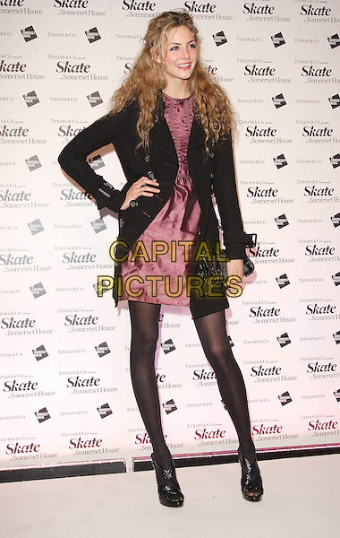 TAMSIN EGERTON.At Somerset House Ice Rink VIP Launch Party, London, England, November 20th 2007..full length pink dress black coat hand on hip tights.CAP/ROS.©Steve Ross/Capital Pictures
