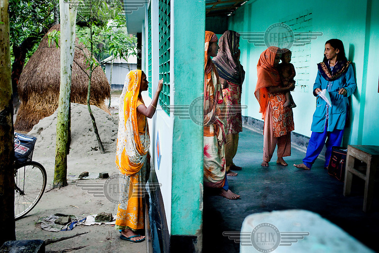 Jesmin Akhter, 26, (in turquoise and blue), sells small products in one of her 'marketplaces', Jerai Villlage. She has found financial independence and contributes to her household income by working as a saleswoman, earning 3500 - 5000 Bangladeshi Taka (GBP 30 - 42) per month. She is the top saleswoman under her 'hub', out of 30 women. Having worked for about 2.5 years, she cycles from village-to-village and door-to-door in a country where women on bicycles is an extremely uncommon sight. She is one of many rural Bangladeshi women trained by NGO CARE Bangladesh as part of their project on empowering women in this traditionally patriarchal society. Named 'Aparajitas', which means 'women who never accept defeat', these women are trained to sell products in their villages and others around them from door-to-door, bringing global products from brands such as BATA, Unilever and GDFL to the most remote of villages, and bringing social and financial empowerment to themselves.