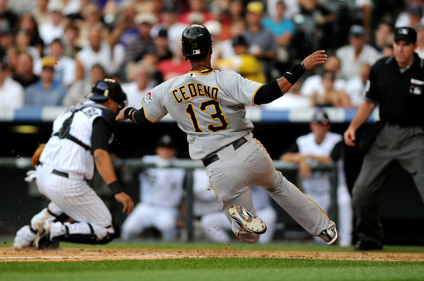 August 13, 2009: Pirates shortstop Ronny Cedeno slides safely into home plate as Rockies catcher Yorvit Torrealba turns to attempt to tag him out during a regular season game between the Pittsburgh Pirates and the Colorado Rockies at Coors Field in Denver, Colorado. The Rockies beat the Pirates 10-1. *****For editorial use only*****