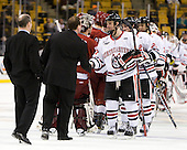 Bruce Irving (Harvard - Volunteer Assistant Coach), Albie O'Connell (Harvard - Assistant Coach), Alex Tuckerman (Northeastern - 27) - The Harvard University Crimson defeated the Northeastern University Huskies 3-2 in the 2012 Beanpot consolation game on Monday, February 13, 2012, at TD Garden in Boston, Massachusetts.