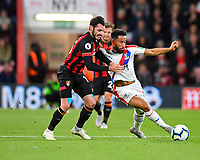 Adam Smith of AFC Bournemouth and Andros Townsend of Crystal Palace vie for the ball during AFC Bournemouth vs Crystal Palace, Premier League Football at the Vitality Stadium on 1st October 2018