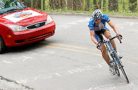 Jason McCartney, of the Discovery Channel Pro Cycling Team, climbs a switchback on Wolf Pen Gap during Stage 4 of the Ford Tour de Georgia. McCartney held two-minute lead up the mountain, but was later reeled in by the main pack. Fred Rodriguez of Davitamon-Lotto won the 118.9-mile (191.4-km) stage from Dalton to Dahlonega.<br />