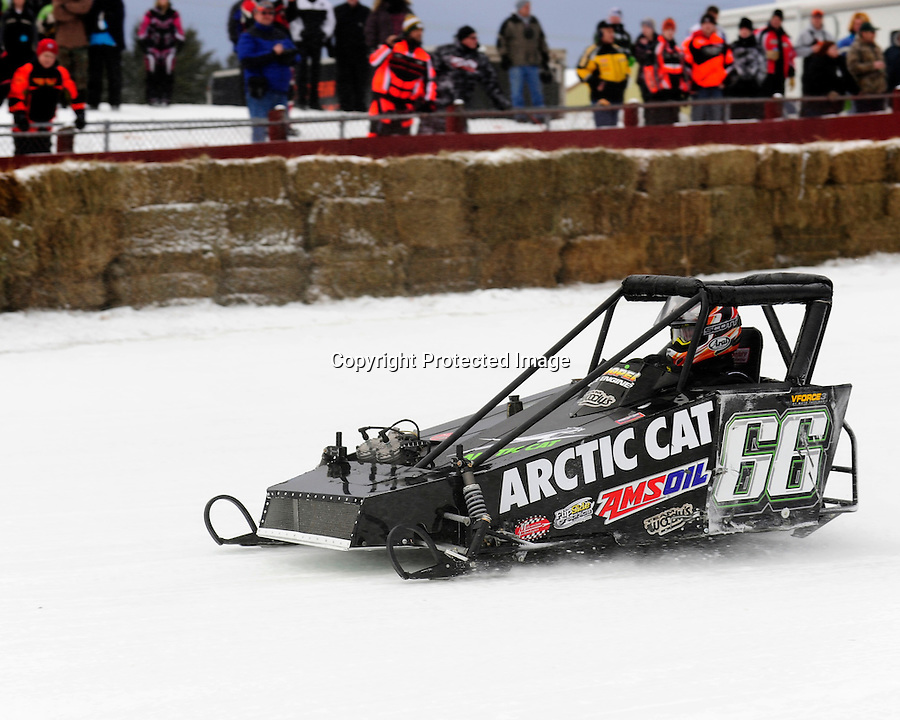 Nick Dolezal of Eagle River, WI races his Outlaw 600 class sled in the AMSOIL World Championship Snowmobile Derby in Eagle River, WI, Jan. 19, 2014.