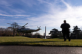 A United States Secret Service Agent stands guard as Marine One carrying United States President Donald J. Trump departs the South Lawn of the White House as Trump travels to meet with wounded service members at Walter Reed Military Hospital in Washington, D.C. on December 21st, 2017. Credit: Alex Edelman / CNP