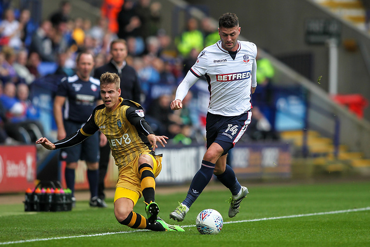 Bolton Wanderers'  Gary Madine imposing his  strength on Sheffield Wednesday's Joost van Aken<br /> <br /> Photographer Andrew Kearns/CameraSport<br /> <br /> The EFL Sky Bet Championship - Bolton Wanderers v Sheffield Wednesday - Saturday 14th October 2017 - Macron Stadium - Bolton<br /> <br /> World Copyright &copy; 2017 CameraSport. All rights reserved. 43 Linden Ave. Countesthorpe. Leicester. England. LE8 5PG - Tel: +44 (0) 116 277 4147 - admin@camerasport.com - www.camerasport.com