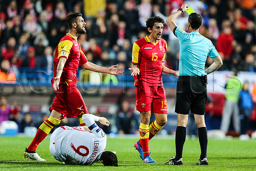 March 26th 2017, Podgorica City Stadium,  Montenegro; World Cup 2018 Internationl football qualification, Montenegro versus Poland;  Robert Lewandowski (POL) hits the deck as Stefan Savic (MNE) gets a card for rough play