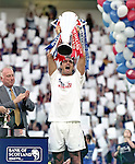 Lorenzo Amoruso lifts the SPL trophy for Rangers in April 2000