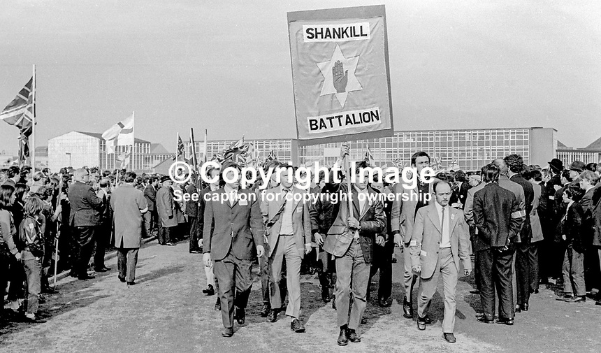 Shankill Battalion arriving at the Ulster Vanguard Rally in Ormeau Park, Belfast, N Ireland, 18th March 1972, 19720318010107<br /> <br /> Copyright Image from Victor Patterson, 54 Dorchester Park, <br /> Belfast, UK, BT9 6RJ<br /> <br /> t1: +44 28 9066 1296 (from Rep of Ireland 048 9066 1296)<br /> t2: +44 28 9002 2446 (from Rep of Ireland 048 9002 2446)<br /> m: +44 7802 353836<br /> <br /> e1: victorpatterson@me.com<br /> e2: victorpatterson@gmail.com<br /> www.victorpatterson.com<br /> <br /> Please see my Terms and Conditions of Use at www.victorpatterson.com. It is IMPORTANT that you familiarise yourself with them.<br /> <br /> Images used on the Internet must be visibly watermarked i.e. &copy; Victor Patterson<br /> within the body of the image and copyright metadata must not be deleted. Images <br /> used on the Internet have a size restriction of 4kbs and will be chargeable at current<br />  NUJ rates unless agreed otherwise.<br /> <br /> This image is only available for the use of the download recipient i.e. television station, newspaper, magazine, book publisher, etc, and must not be passed on to any third <br /> party. It is also downloaded on condition that each and every usage is notified within 7 days to victorpatterson@me.com<br /> <br /> The right of Victor Patterson to be identified as the author is asserted in accordance with The Copyright Designs And Patents Act (1988).