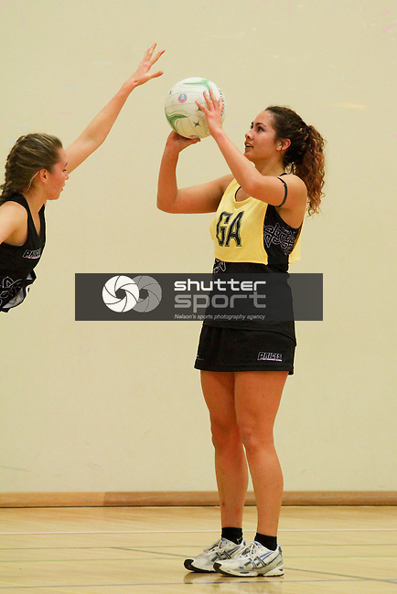 Prices Pharmacy A v Prices Pharmacy Black, Nelson Premier Netball, 27 June 2013, Nelson College for Girls, Nelson, New Zealand<br /> Photo: Marc Palmano/shuttersport.co.nz