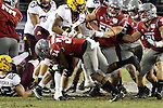 Jalen Thompson (34) makes the tackle, minus one shoe, while teammates Hercules Mata'afa (50), Isaac Dotson (31) provide assistance, during the National Funding Holiday Bowl game against the Minnesota Golden Gophers in San Diego, California, on December 27, 2016.