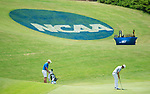 MUSCLE SHOALS, AL - MAY 25: Lynn's Manuel Torres putts as West Florida's Jacob Huizinga looks on at the 18th green during the Division II Men's Team Match Play Golf Championship held at the Robert Trent Jones Golf Trail at the Shoals, Fighting Joe Course on May 25, 2018 in Muscle Shoals, Alabama. Lynn defeated West Florida 3-2 to win the national title. (Photo by Cliff Williams/NCAA Photos via Getty Images)