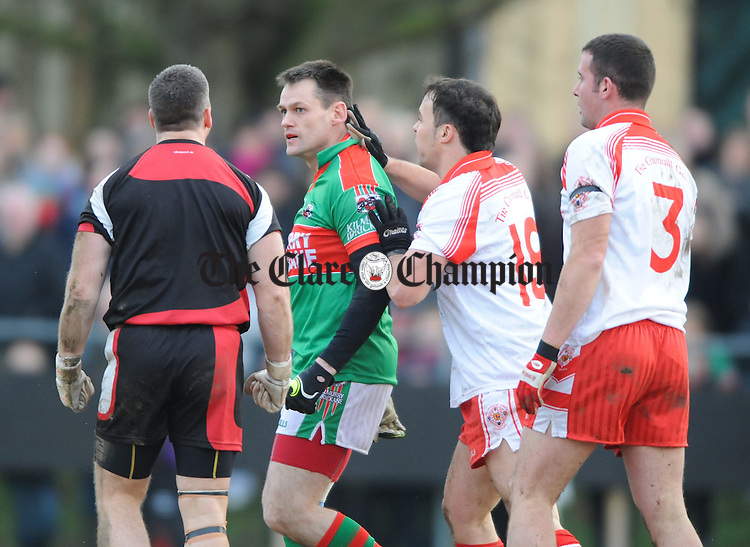 Odran O Dwyer of Kilmurry Ibrickane gets a few words from Tir Chonaill Gaels goalie Brian Mc Brearty as well as David Cannon and Patrick Callaghan during their All-Ireland club quarter final in Ruislip. Photograph by John Kelly.