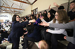 Elyse Monroy, a staffer from Nevada Gov. Brian Sandoval's office, hands out anti-bullying wrist bands before Sandoval signs an anti-bullying bill into law at Carson Middle School in Carson City, Nev., on Wednesday, May 20, 2015. <br /> Photo by Cathleen Allison