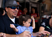 Aug. 31, 2013; Clermont, IN, USA: NHRA funny car driver Cruz Pedregon with daughter during qualifying for the US Nationals at Lucas Oil Raceway. Mandatory Credit: Mark J. Rebilas-