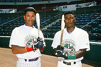 Jose Cruz ,jr of the Lancaster JetHawks and Miguel Tejada of the Modesto A's pose for a photo before the Carolina League versus California League All Star Game during the 1996 season at The Epicenter in Rancho Cucamonga, California. (Larry Goren/Four Seam Images)