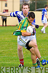 Lios Póil Kieran O'Sullivan in possession of the ball tackled by Annascaul James Scanlon during the County League Div. 3 match at Lispole GAA grounds on Sunday afternoon.