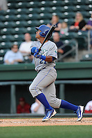 Left fielder Alfredo Escalera-Maldonado (21) of the Lexington Legends bats in a game against the Greenville Drive on Tuesday, April 14, 2015, at Fluor Field at the West End in Greenville, South Carolina. Lexington won, 5-3. (Tom Priddy/Four Seam Images)